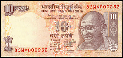 start symbol on indian bank note